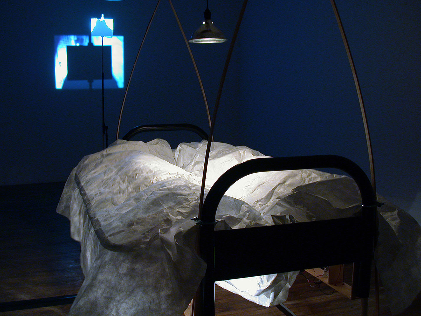 Diane Landry, The Magic Shield (detail), 2005, installation with automation, 2 futon-frame-beds, motors, selected objects, aluminum, wood, halogen lamp, MIDI controller, computer.